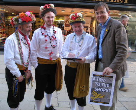 Martin Tod collects Trip to the Shops signatures from Christmas Clog Morris Dancers in Winchester High Street