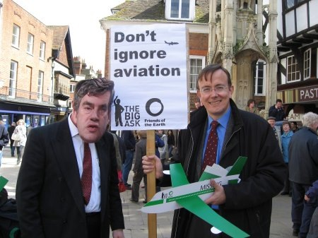 Martin Tod and Dave Walker-Nix from Winchester Friends of the Earth campaigning for aviation to be included in the Climate Change Bill by the Butter Cross in Winchester
