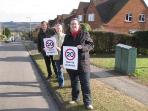 Martin Tod, Phryn Dickens and Rose Prowse standing on Battery Hill with 20 mph signs